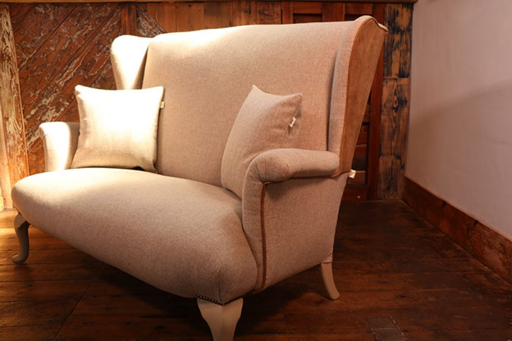Parker Knoll two seater sofa newly upholstered in Moon & Moon Fabric