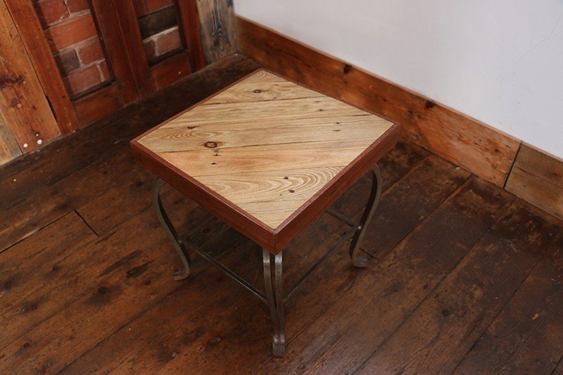 Square side table made from reclaimed pallet wood and decorative steel base