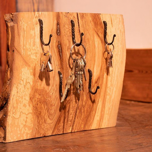 Free standing key holder made from drift wood finished with decorative hooks