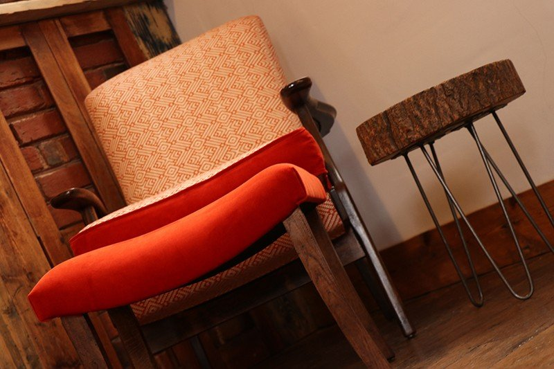 Parker Knoll armchair and footstool in Linwood Orange Tango Weaves and Velvet