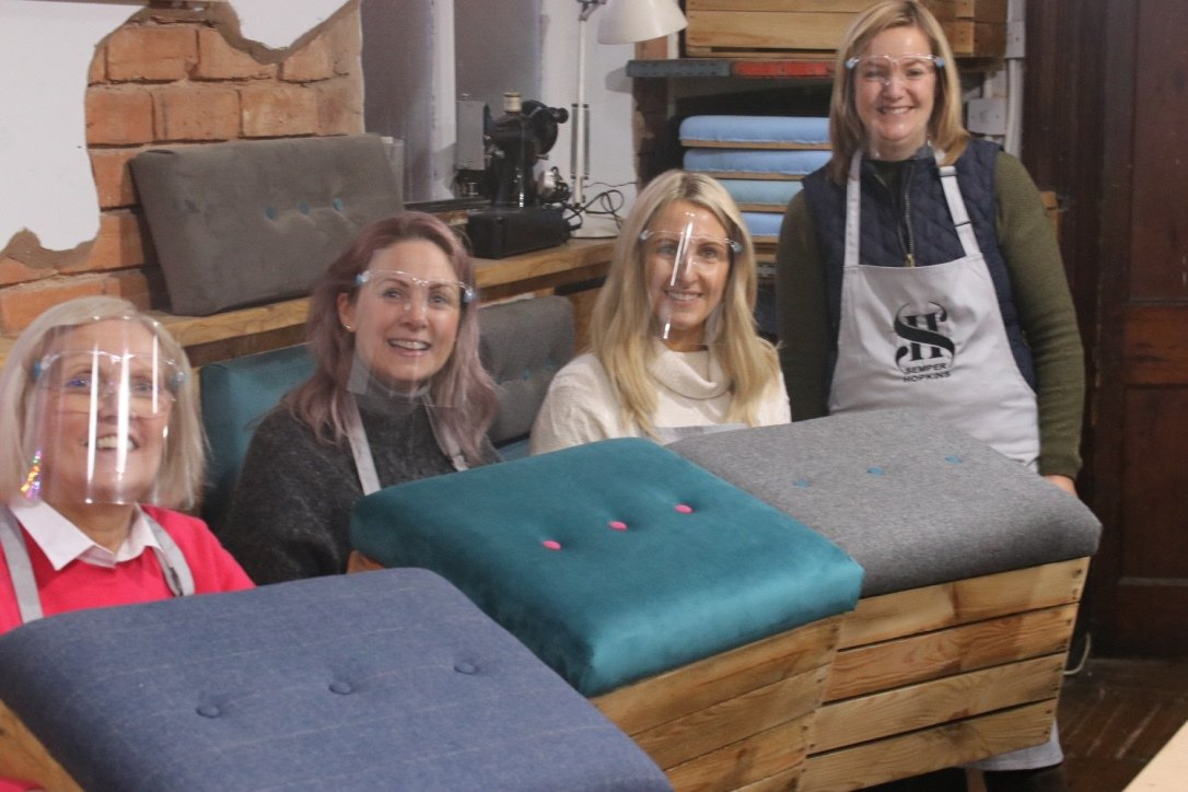 Picture of clients with their crate in workshop