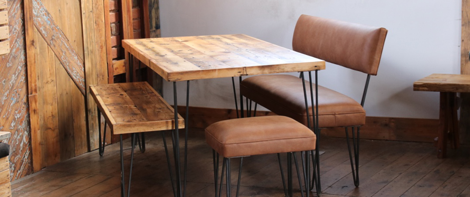 Dining table made from reclaimed flooring with wooden edge