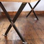 Cross leg base