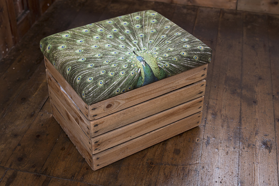 Storage crate with peacock fabric
