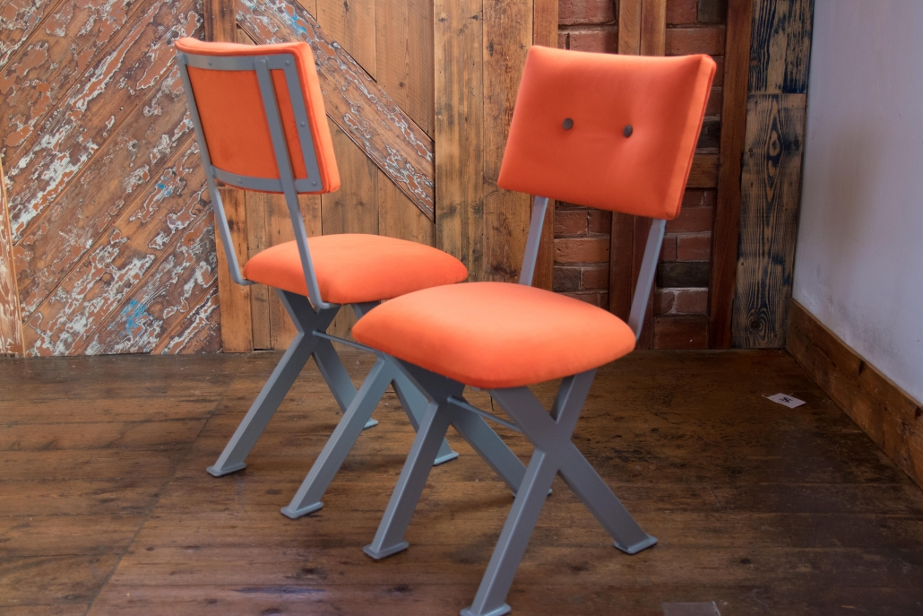 industrial chair with steel legs and contrast button