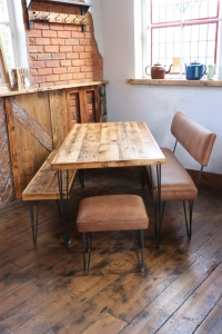 Reclaimed wooden dining table with custom wooden bench and leather industrial bench
